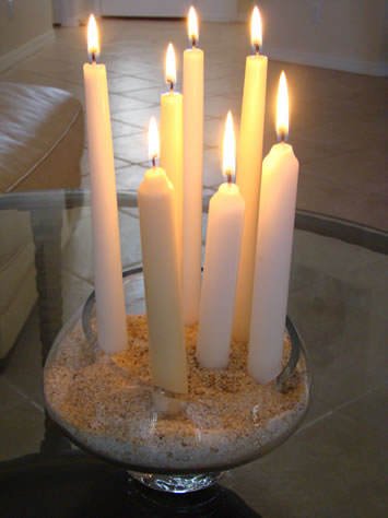 Pretty White Candles Mounted in Sand - MattandShari.com