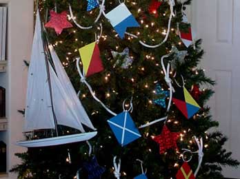 junes tree is filled with nautical flags and sailboats