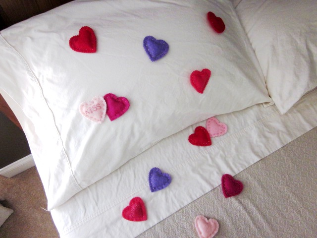 Felt Hearts Sprinkled on Bed
